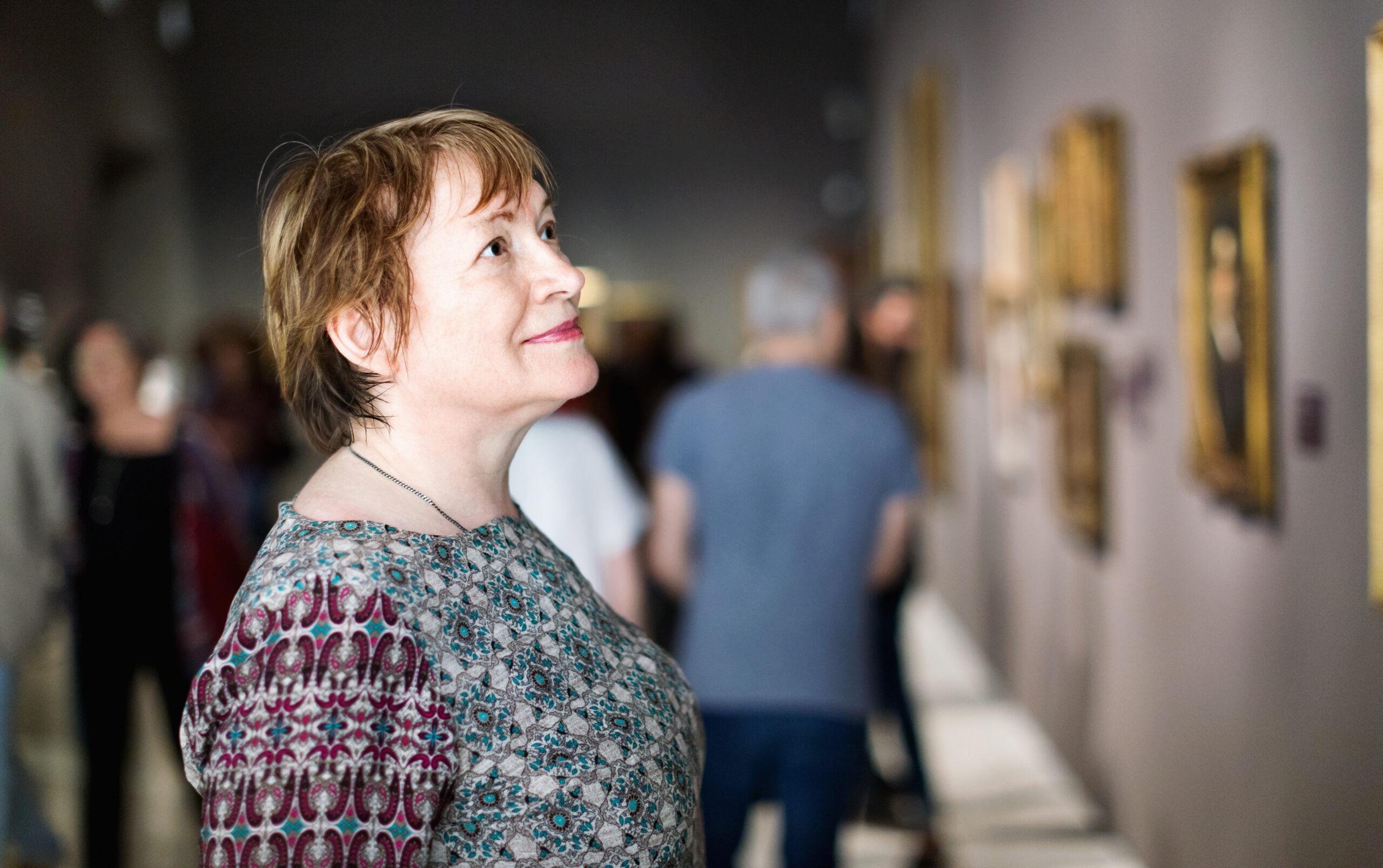 Woman enjoys a gallery visit.